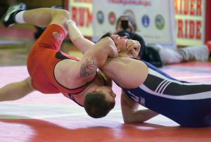 US Marine Corps (USMC) Corporal (CPL) Jacob Clark (dressed in red), a member of the All Marines Wrestling Team, competes in a Freestyle wresting match against a member of the All US Navy (USN) Team, during the Armed Forces Wrestling Championship held in New Orleans, Louisiana (LA).