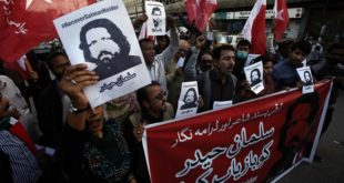 Supporters of Awami Worker Party hold a demonstration to condemn the missing human rights activists, in Karachi, Pakistan, Tuesday, Jan. 10, 2017. International and local rights groups on Tuesday urged the Pakistani government to investigate the abductions last week of four anti-Taliban activists — disappearances that critics claim reflect a crackdown on secular dissent. (AP Photo/Fareed Khan)