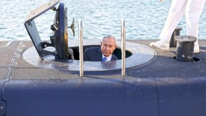 Israeli Prime Minister Benjamin Netanyahu climbs out after a visit inside the Rahav, the fifth submarine in the fleet, after it arrived in Haifa port January 12, 2016. The Dolphin-class submarines, widely believed to be capable of firing nuclear missiles, were manufactured in Germany and sold to Israel at deep discounts as part of Berlin's commitment to shoring up the security of the country set in part as a haven for Jews who survived the Holocaust.REUTERS/Baz Ratner - RTX221FU